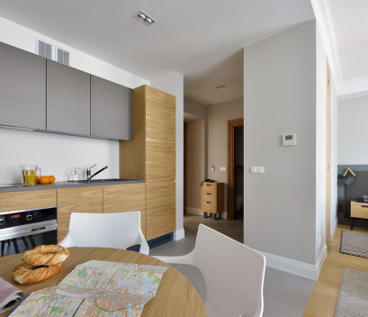 studio-apartment-with-kitchen-table-and-bed