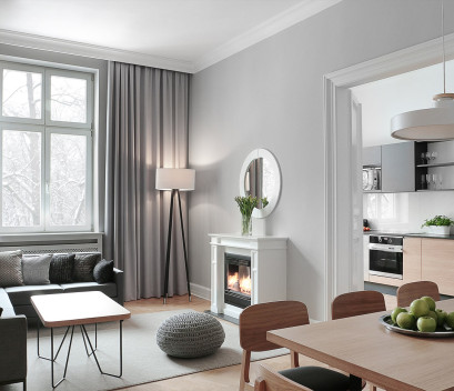 spacious-apartment-cosy-living-room-table-fireplace-winter